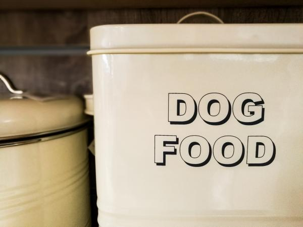 Large white metal tin of dog food