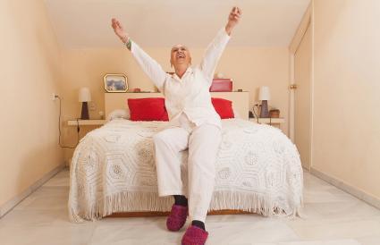 mature woman in her bedroom