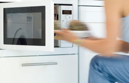 Putting a dish in the microwave