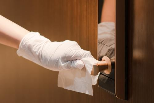 Disinfecting door handle