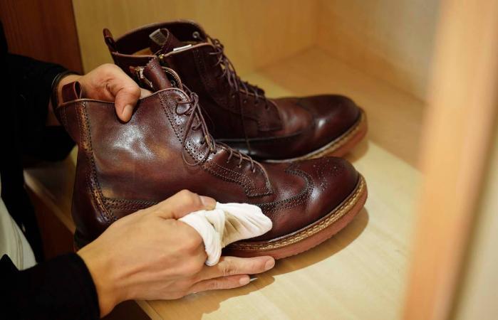 Man polishing leather shoes