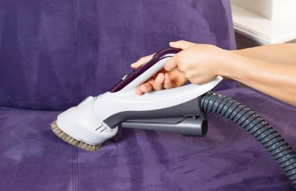 Cleaning Leather Sofa with Vacuum Brush