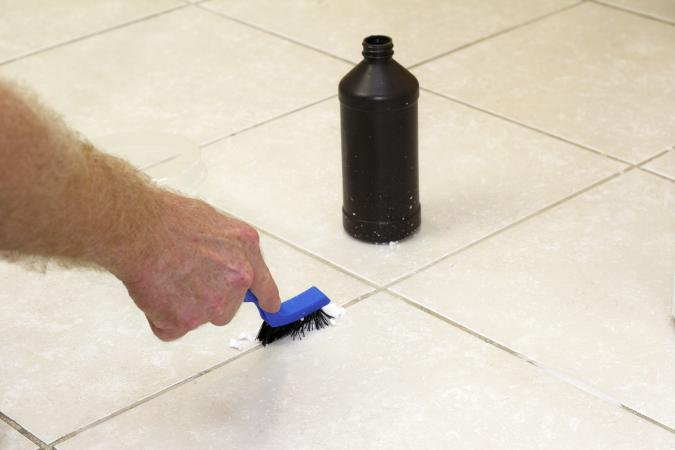 Grout cleaning using peroxide