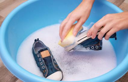 Woman washing sneakers sole