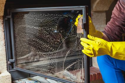 Cleaning fireplace glass with Scrubbing Bubbles