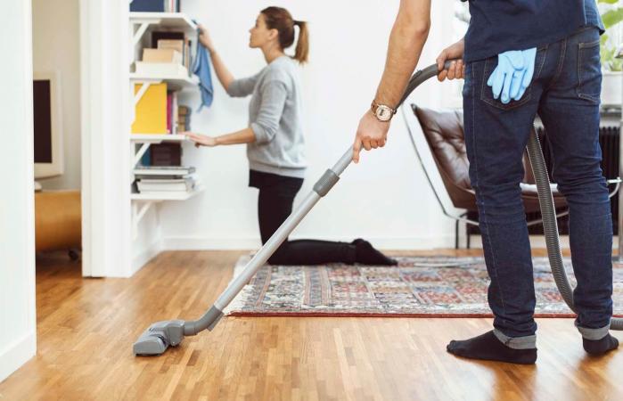 man vacuuming floor