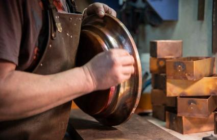 man polishing the copper detail