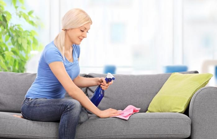 woman cleaning a couch