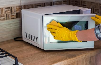 women's hands wash the microwave