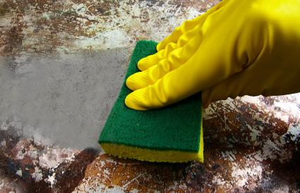 scrubbing a dirty metal surface