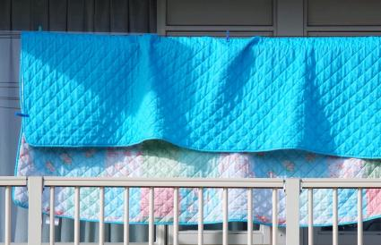Blanket hanging at balcony