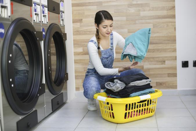 Young woman at a laundromat