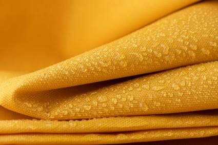 Folded canvas of yellow wet fabric