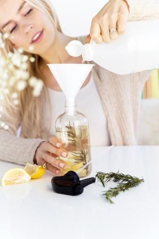 Woman making a homemade natural cleaner