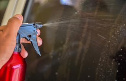 Spraying WD 40 on car