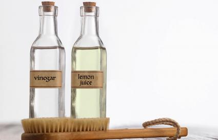 Vinegar and lemon juice by brush