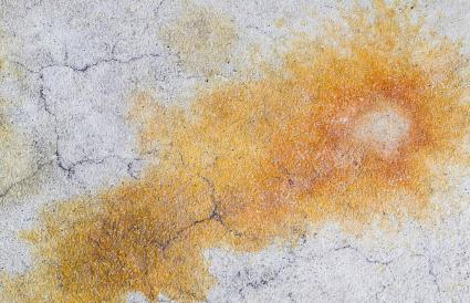 rust stain on a garage floor