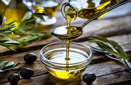 Pouring extra virgin olive oil