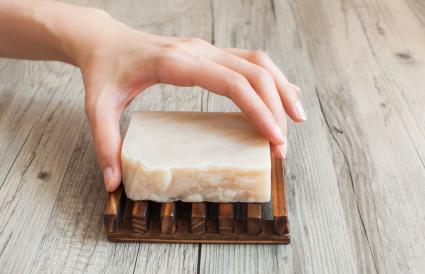 Hand holding bar soap
