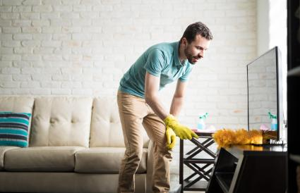 man cleaning with a duster