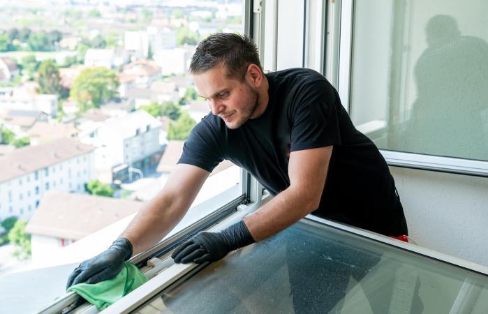 Man cleaning window tracks