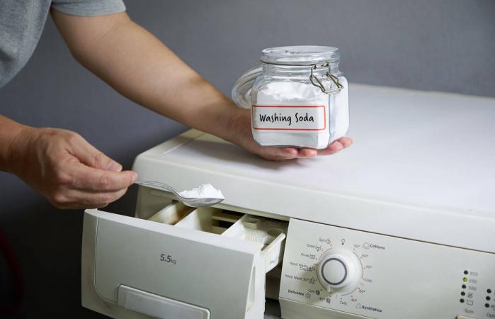 adding baking soda into washing machine