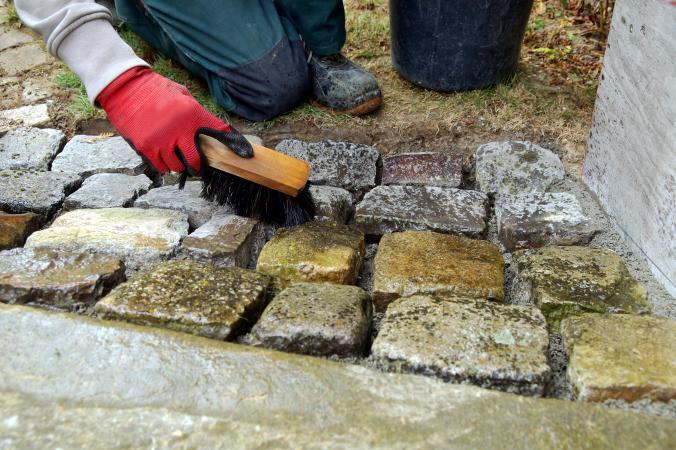 cleaning brick with stiff bristle brush