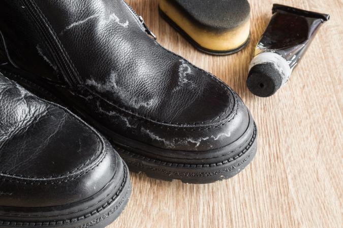 mens black shoes damaged from salt stains