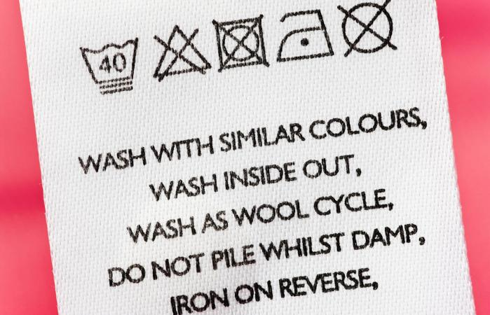 laundry care symbols on clothing tag