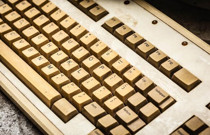 yellowed dusty pc keyboard