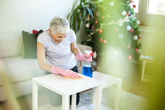 Woman cleaning house for Christmas