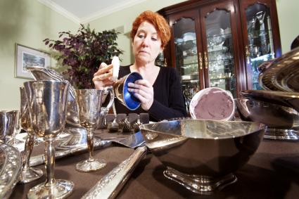 Woman polishing silver