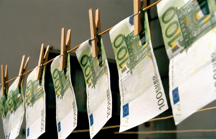 Money hanging on a washing line