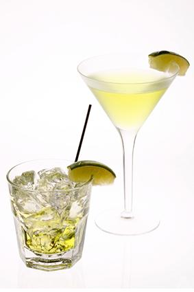 Two Gimlet drinks with lime wedges