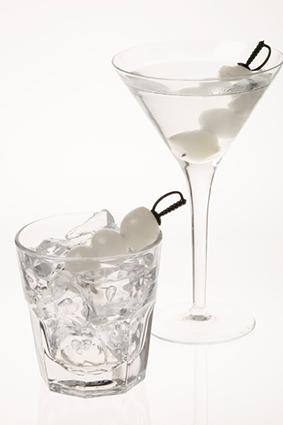 Gibson drinks with cocktail onions on sword picks