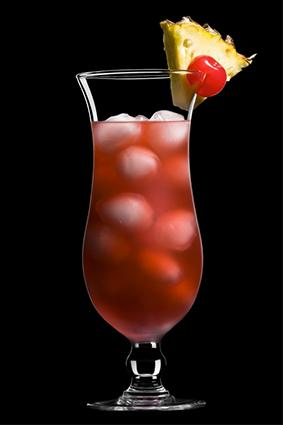 Singapore Sling gin drink with pineapple and cherry