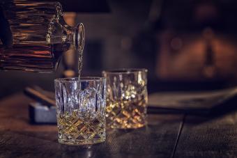 Pouring bourbon into glasses