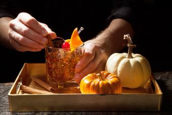 Preparing Old Fashioned Whiskey Cocktail on bar counter