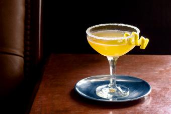 Sidecar Cocktail Served Up with Sugared Rim in Dark Luxurious Bar