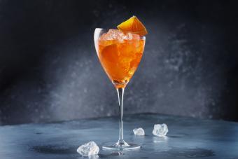 Traditional Italian aperitif Aperol Spriz with orange and ice