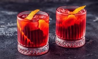 Negroni cocktail with orange peel and ice