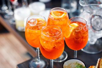 Spritz cocktail in misted glass with orange