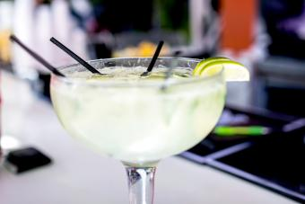 White cocktail with lime and coconut