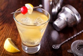 Frangelico sour cocktail on a wooden bar counter top