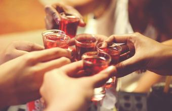 Friends toasting with pink whitney shot
