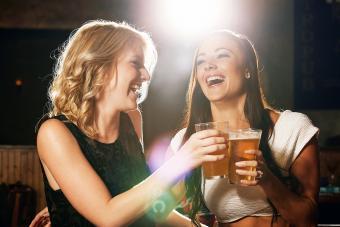 Women enjoying her drinks together in a nightclub