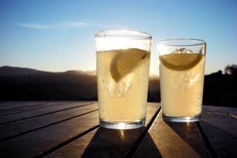 Two brandies rebujito on table against blue sky