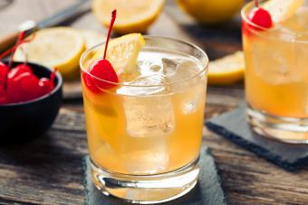 Whiskey Sour Cocktail Drink with a Cherry and Lemon