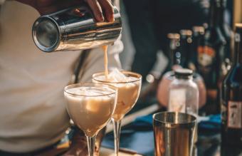 Bartender preparing Irish Cream Liqueur cocktail