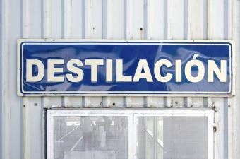 Spanish-language sign stating 'Destilación' [Distillation] on the outside of a tequila factory